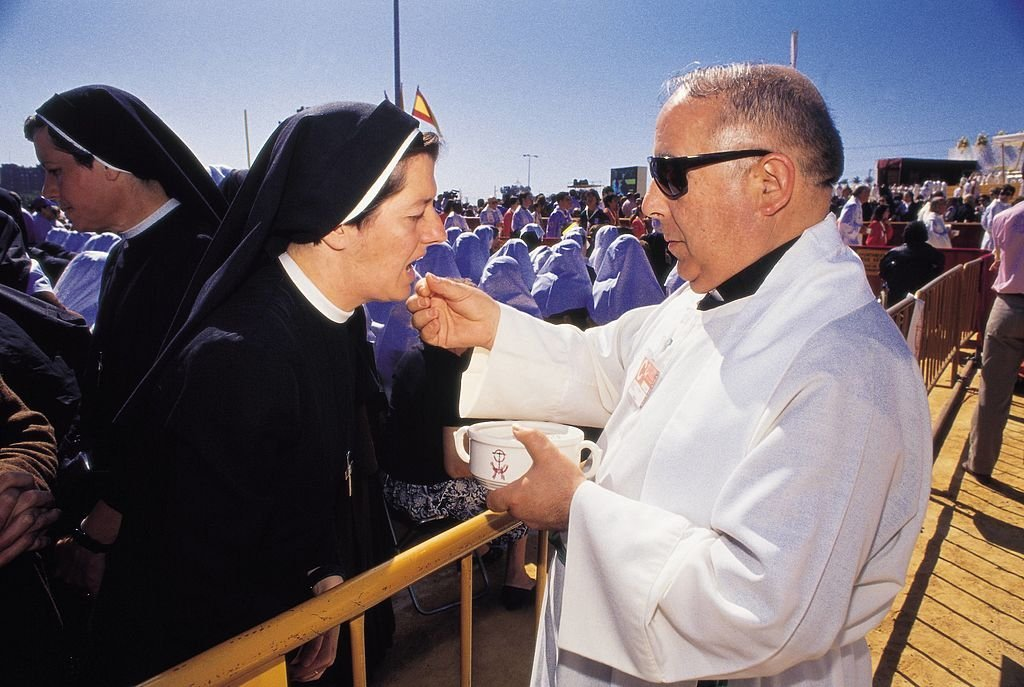 Priest giving the communion | Source: Getty Images