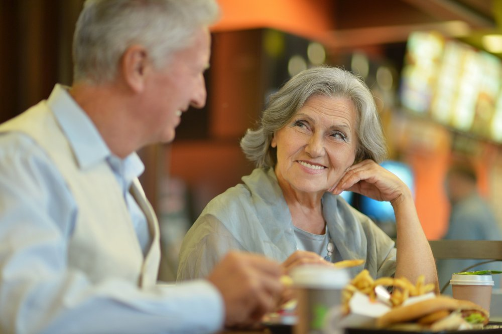 Elderly couple exchanging a glance at a restaurant | Photo: Shutterstock