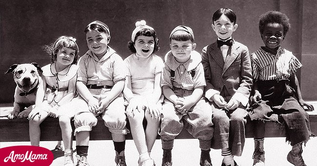 Our Gang (from left: Pete the pup, Darla Hood (1931-1979), US child actress, George McFarland (1928-1993), US child actor, Dorothy DeBorba (1925-2010), Eugene Gordon Lee (1933-2005), Carl Switzer (1927-1959), US child actor, and Billie Thomas (1931-1980)) pose for a publicity portrait, circa 1935.| Source: Getty Images