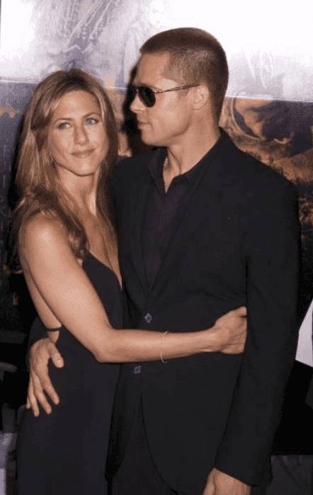 "Brad Pitt and Jennifer Aniston embrace each other at the premiere for ""Troy,"" at the Ziegfeld Theater, on October 4 2004 