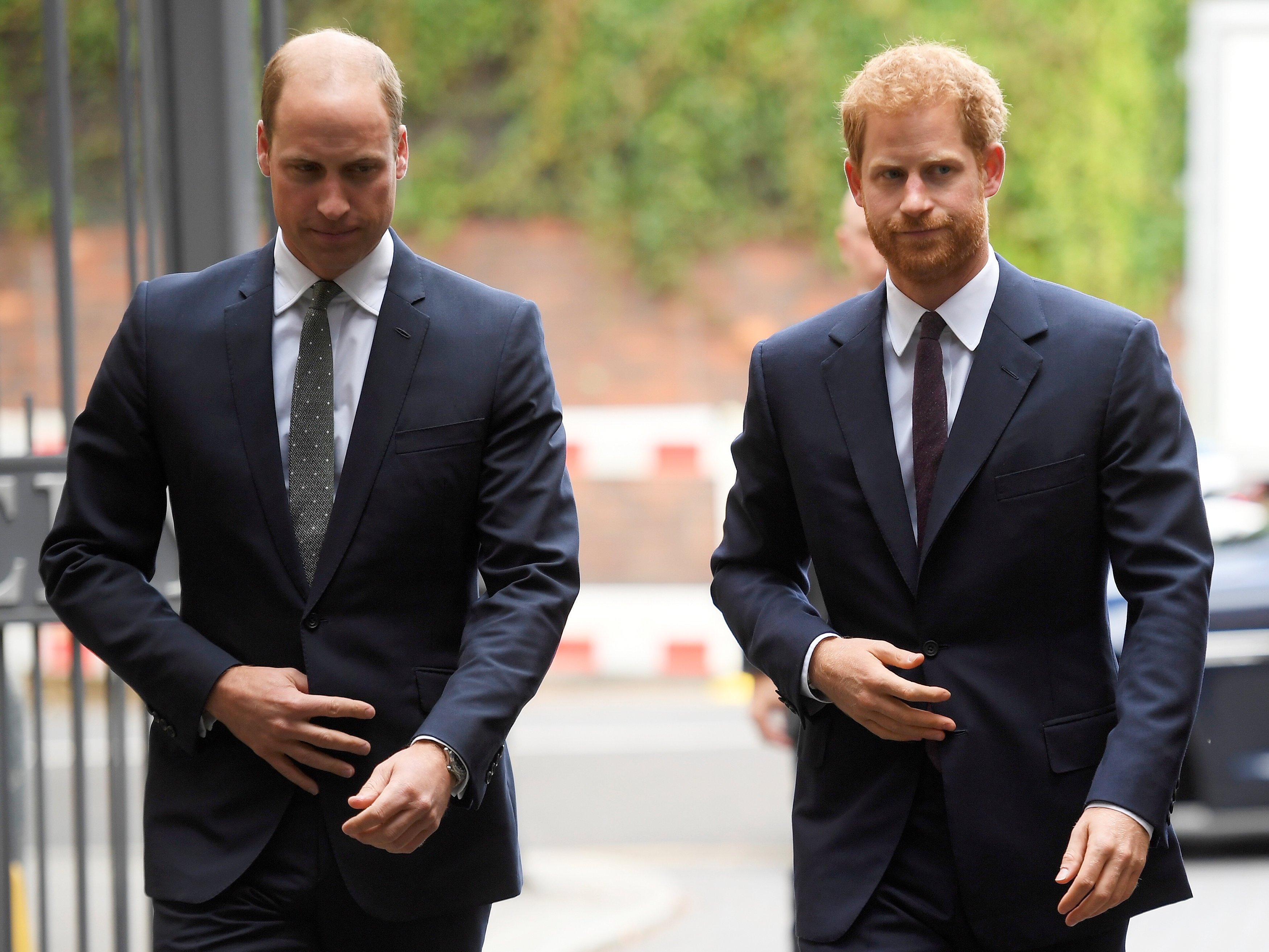 Prince William and Prince Harry arrive during a visit to the newly established Royal Foundation Support4Grenfell community hub on September 5, 2017 in London, England | Photo: Getty Images