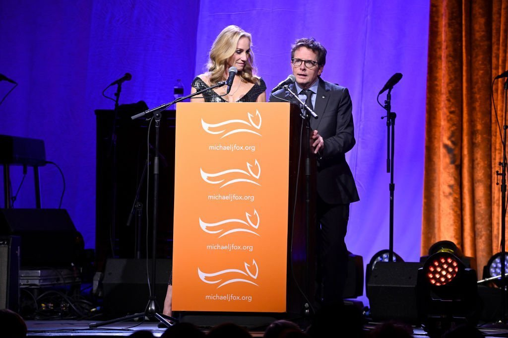Tracy Pollan and Michael J. Fox speak on stage at A Funny Thing Happened On The Way To Cure Parkinson's | Getty Images