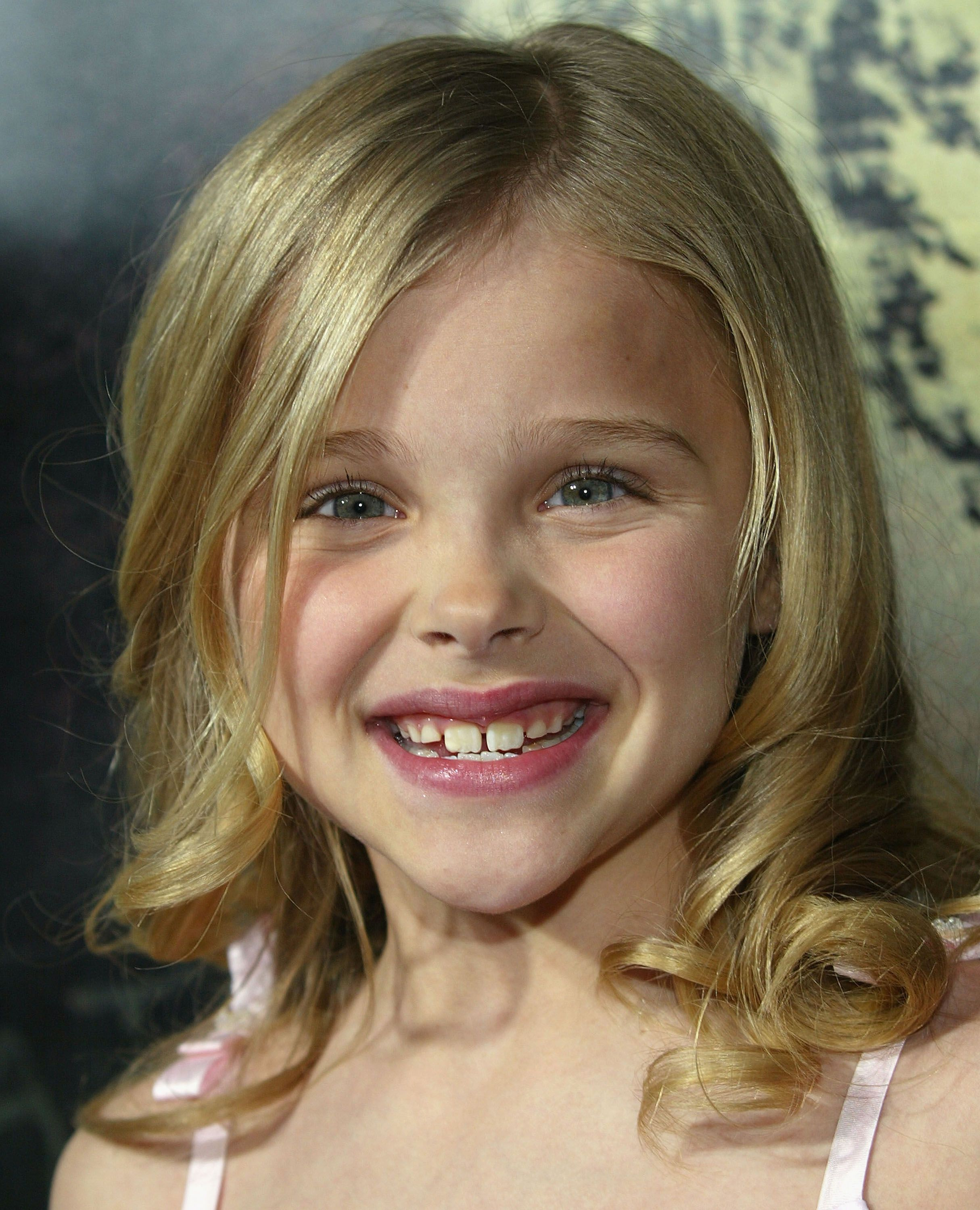 "11-year-old Chloë Grace Moretz at the premiere of ""The Amityville Horror"" in 2005 in Los Angeles, California Source: Getty Images"