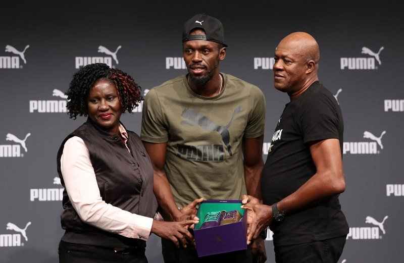 Usain Bolt with his parents, Jennifer and Wellesley Bolt, at The Brewery, in London, United Kingdom in August 2017 | Photo: Getty Images