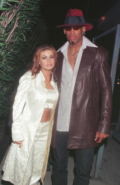 Dennis Rodman and Carmen Electra in Beverly Hills, CA, February 26, 1999. | Photo: Getty Images