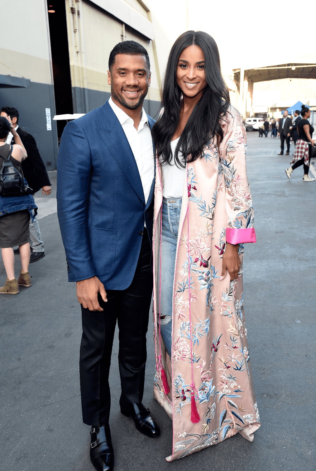 """NFL player Russell Wilson and singer Ciara pose backstage during """"One Voice: Somos Live! A Concert For Disaster Relief"""" at the Universal Studios Lot on October 14, 2017. 
