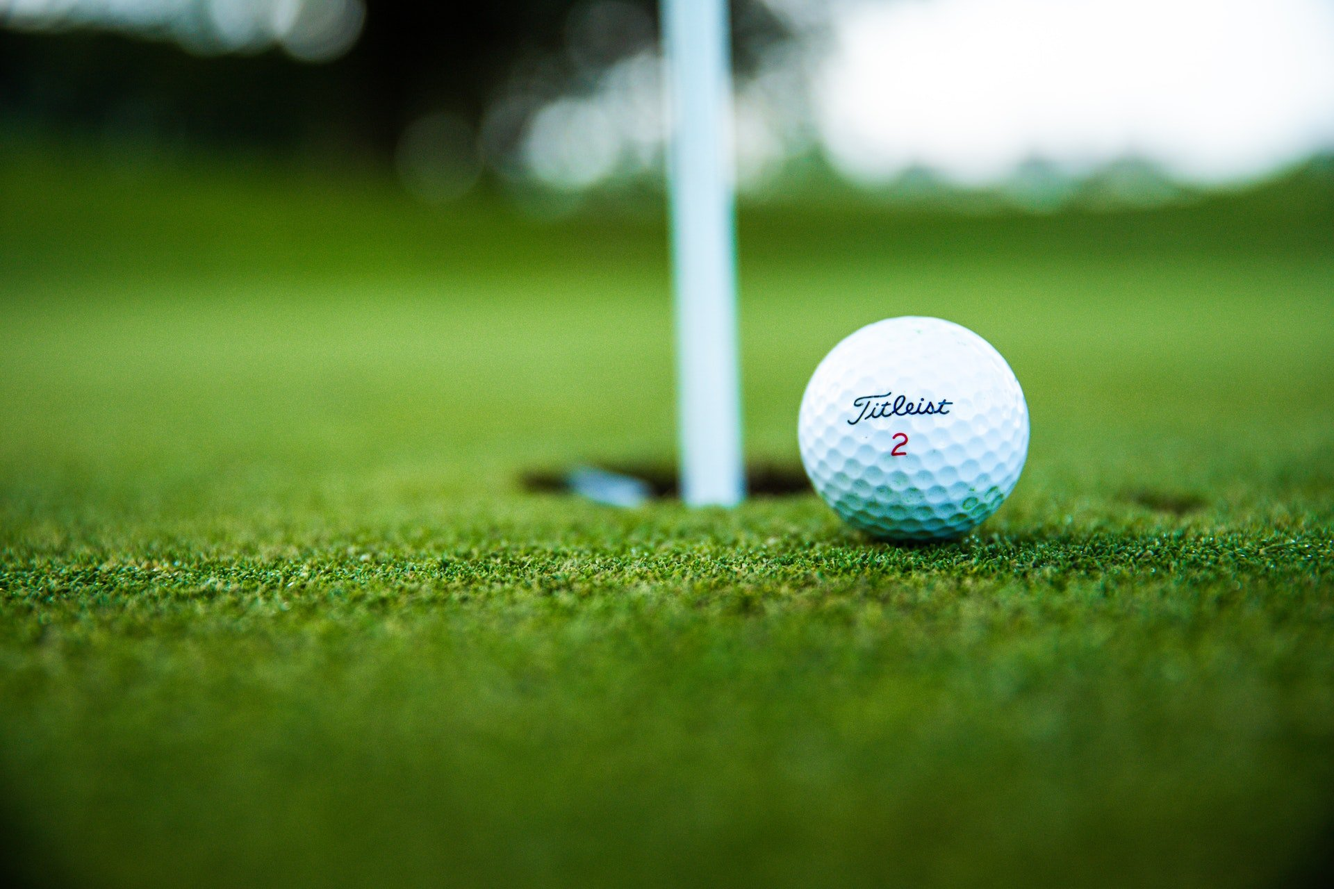 A picture of a golf ball close to a hole on a golf course in Westminster, United States   Photo: Pexels/Thomas Ward