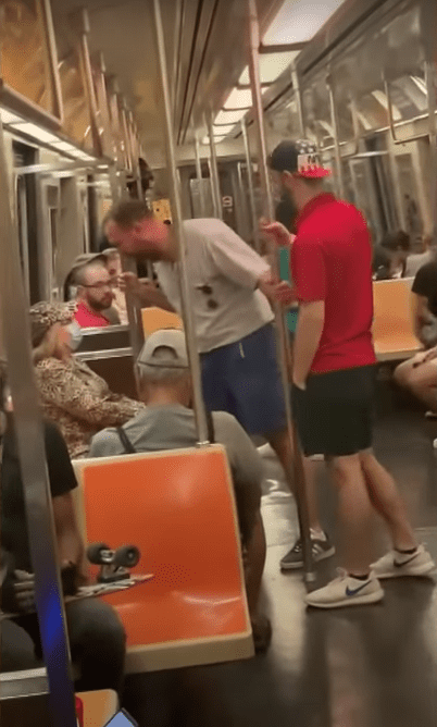 A 27-year-old man yelling at an elderly woman on the New York City subway.   Source:  youtube.com/InsideEdition