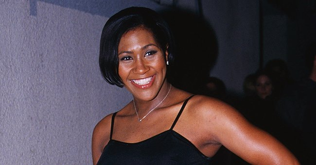 Terri J Vaughn Poses in a Floral Dress on Her Birthday & Accessorizes with Massive Gold Jewelry