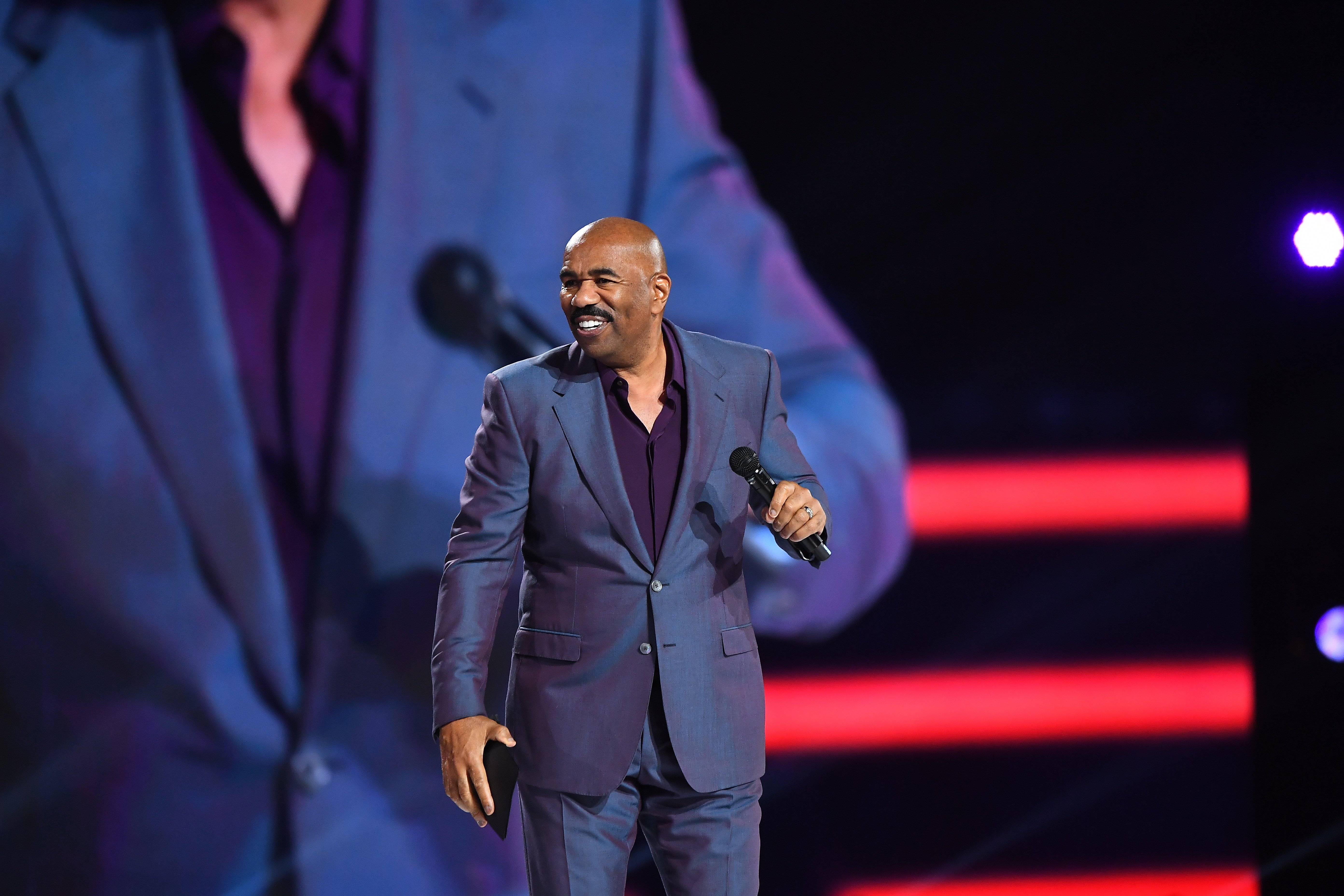 Steve Harvey speaks at the Beloved Benefit event in Atlanta, Georgia on March 21, 2019 | Photo: Getty Images