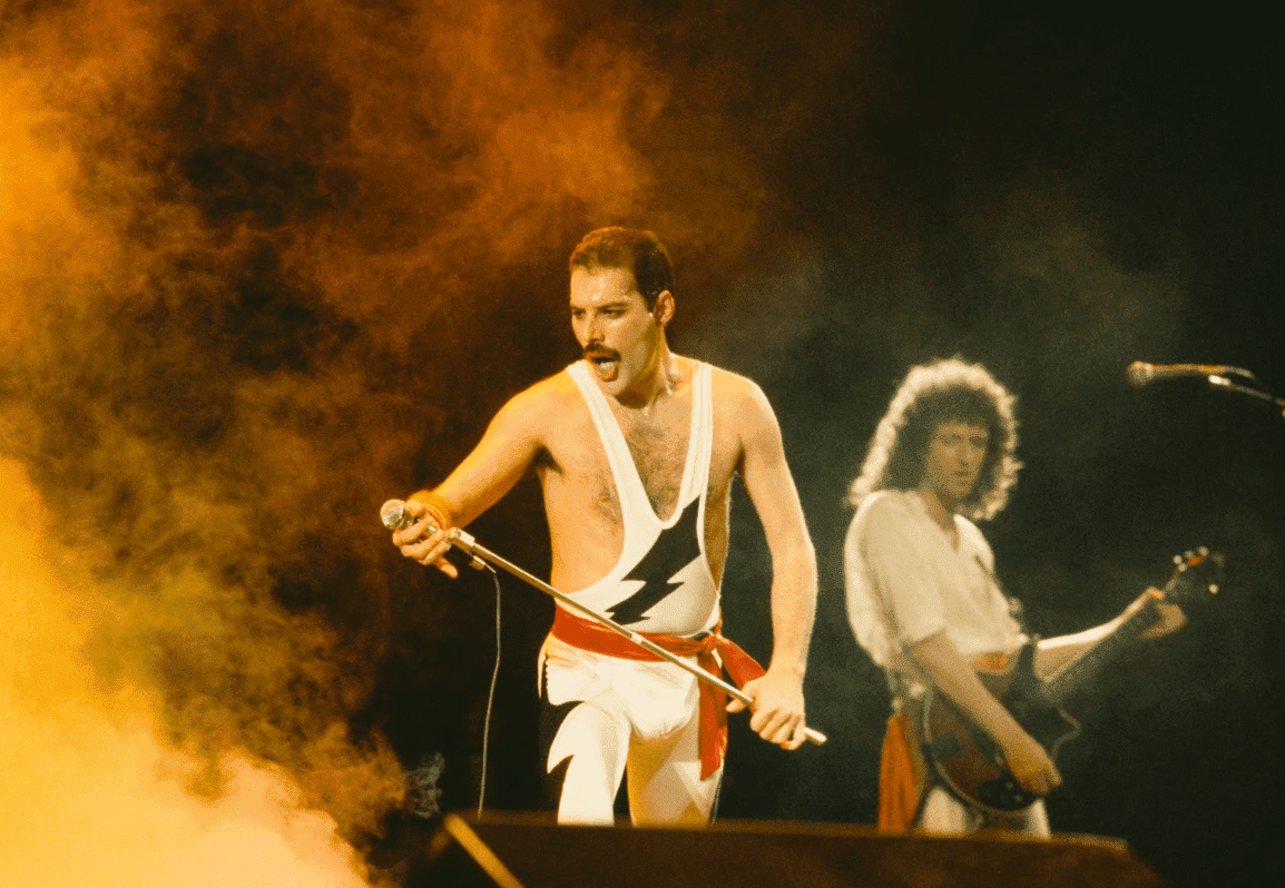 Freddie Mercury and Brian May on stage during Queen's performance at the Rock in Rio festival, Brazil, January 1985. | Source: Getty Images