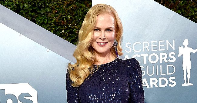Nicole Kidman Rocks Natural Curly Hair and Shows off Tiny Waist in a Gorgeous Red Dress