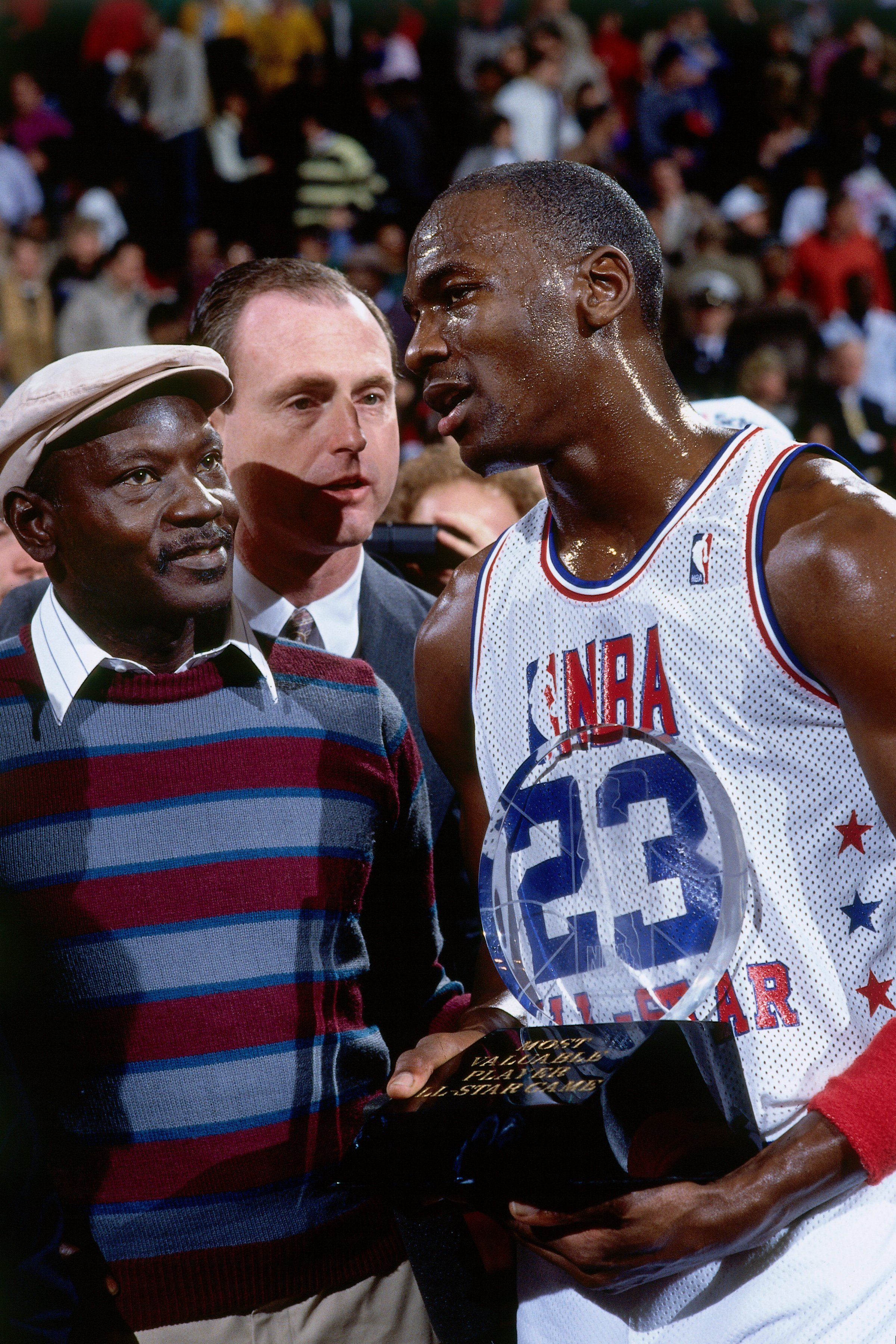 Michael Jordan #23 of the Eastern Conference All Stars stands on the court with his father James Jordan after recieving the MVP award in 1988 at Chicago Stadium in Chicago | Photo: GettyImages