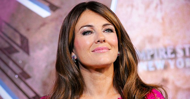 Elizabeth Hurley, 55, Stuns Posing in a Chic High-Slit Emerald Green Dress — See Fan Reactions