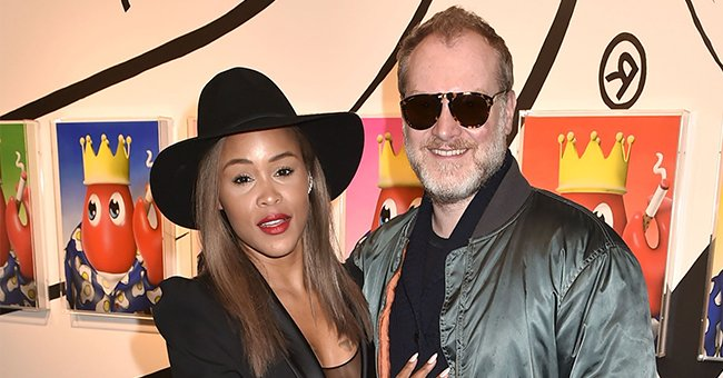 Eve's Millionaire Husband Shares Pic of Her in a Cleavage-Revealing Orange Dress & Brown Boots