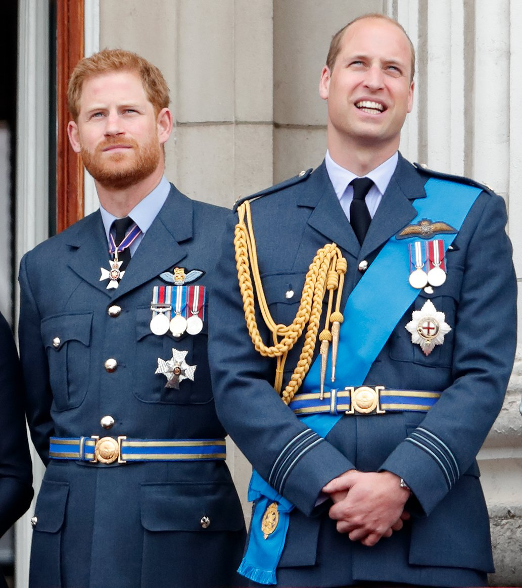 Prince Harry and Prince William look up at a flypast during the Royal Air Force centenary event at the Buckingham Palace on July 10, 2018 | Photo: Getty Images