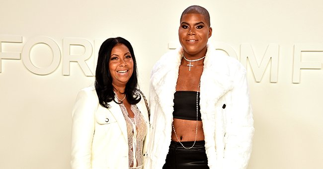 Magic Johnson's Son EJ Stuns in Tight Pants, Black Top & White Coat in Photos with Mom Cookie at NYFW 2020