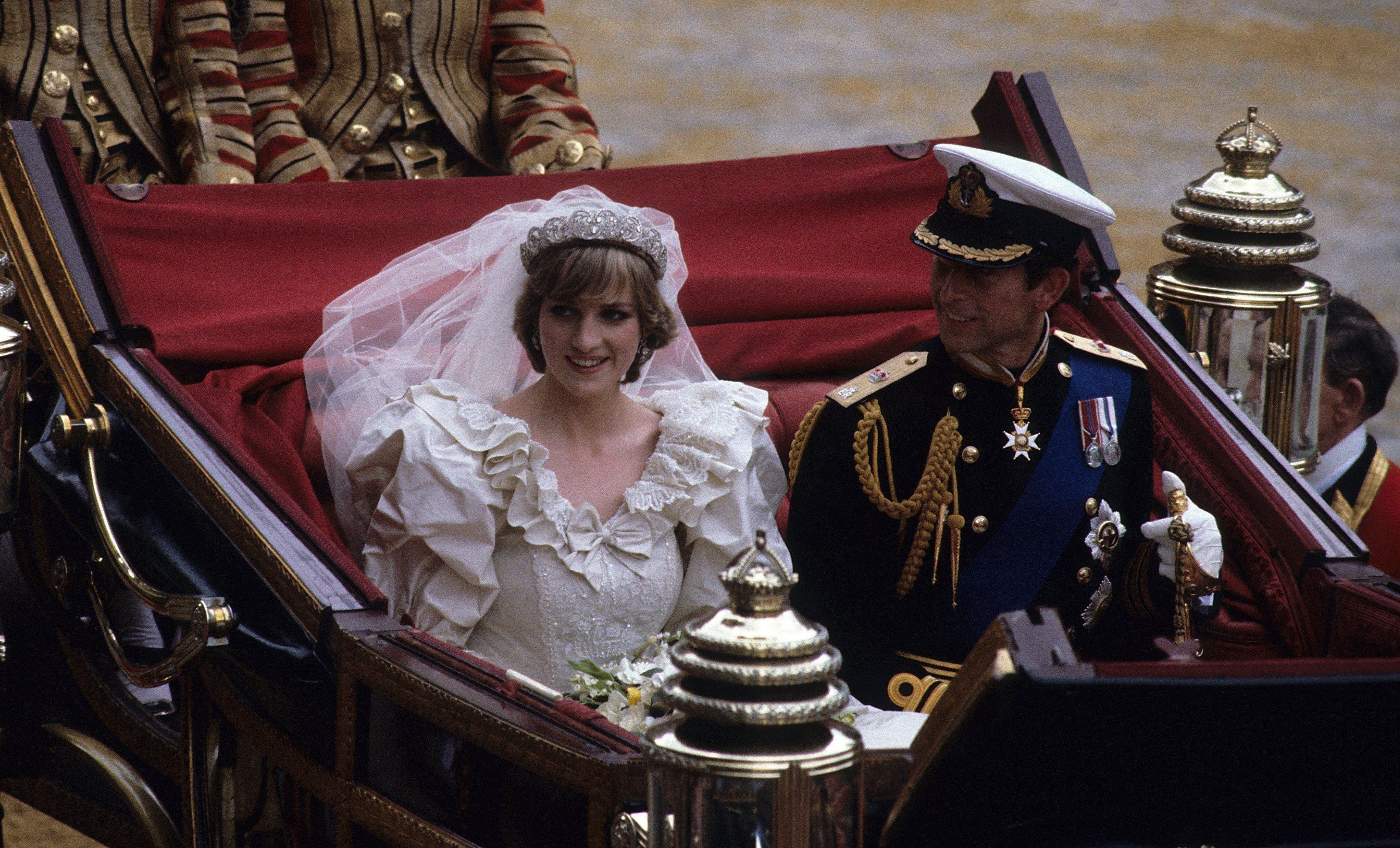 Prince Charles and Princess Diana rode in an open carriage, from St. Paul's Cathedral to Buckingham Palace, following their wedding on July 29, 1981   Photo: Getty Images