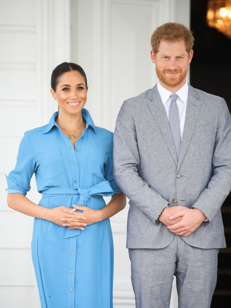 Prince Harry, and Meghan Markle standing with King Tupou VI and Queen NanasipauÔu TukuÔaho of Tonga at the farewell with His Majesty King Tupou VI on October 26, 2018 in Nuku'alofa, Tonga | Photo: Getty Images