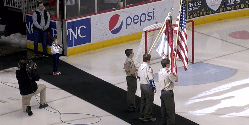 Landon Mak singing the national anthem at the hockey game. | Photo: Facebook/Hershey Bears.