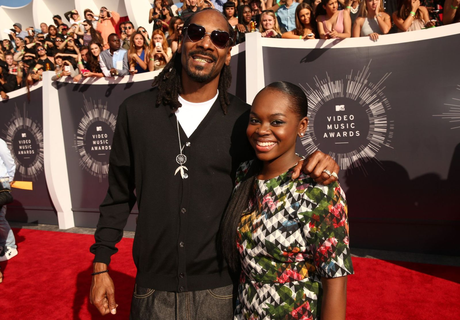 Recording artist Snoop Dogg and Cori Broadus at the 2014 MTV Video Music Awards at The Forum on August 24, 2014 | Photo: Getty Images
