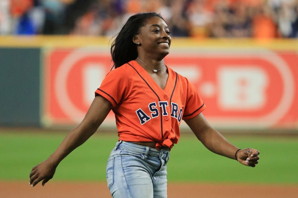 Gymnast Simone Biles throws out the ceremonial first pitch prior to Game Two of the 2019 World Series between the Houston Astros and the Washington Nationals at Minute Maid Park | Photo: Getty Images