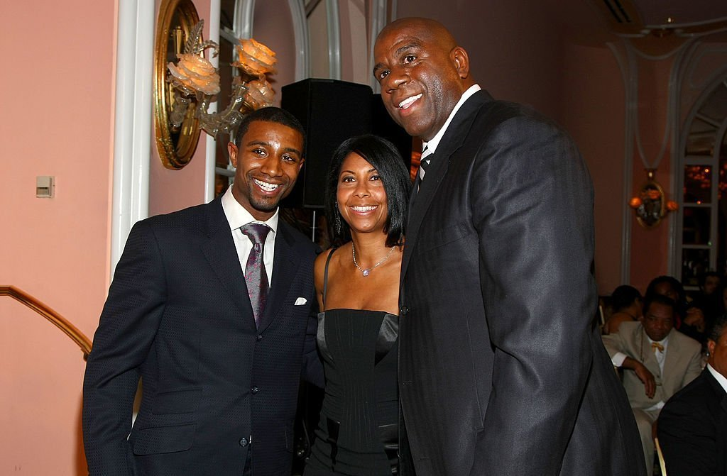Former NBA player Earvin 'Magic' Johnson, (R) his wife Cookie (C) and their son Andre Johnson attend the USA TODAY Hollywood Hero | Getty Images / Global Images Ukraine