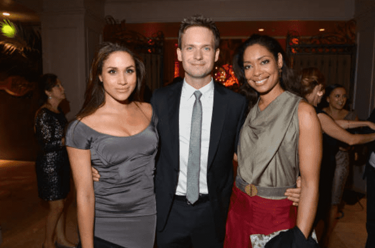 """""""Suits"""" cast members: Meghan Markle, Patrick J. Adams and Gina Torres pose at a Toronto International Film Festival Party, at Windsor Arms Hotel, on September 11, 2012, in Toronto, Canada 