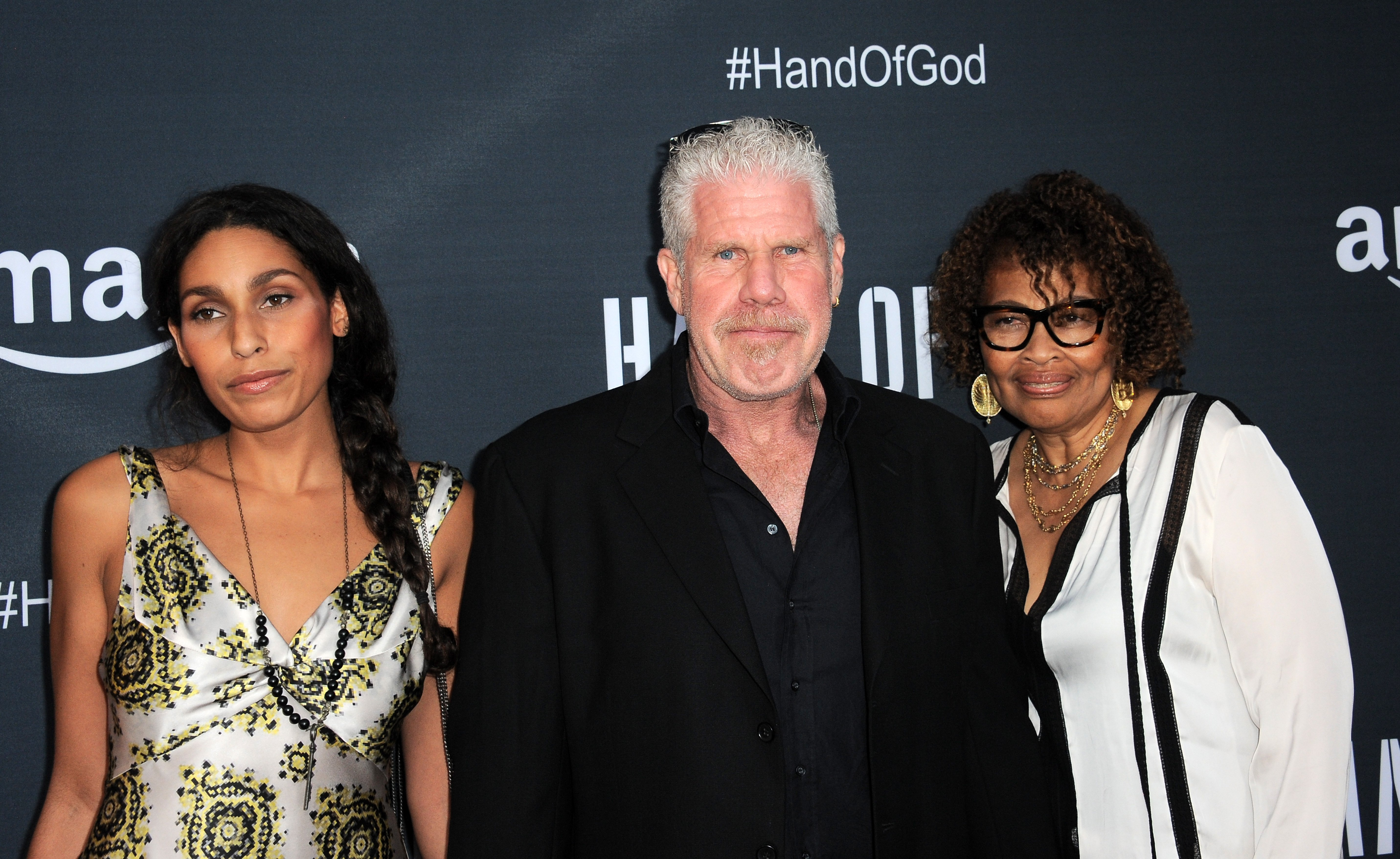 "Blake Perlman, Ron Perlman and Opal Stone arrive for the Premiere Of Amazon's Series ""Hand Of God."" 
