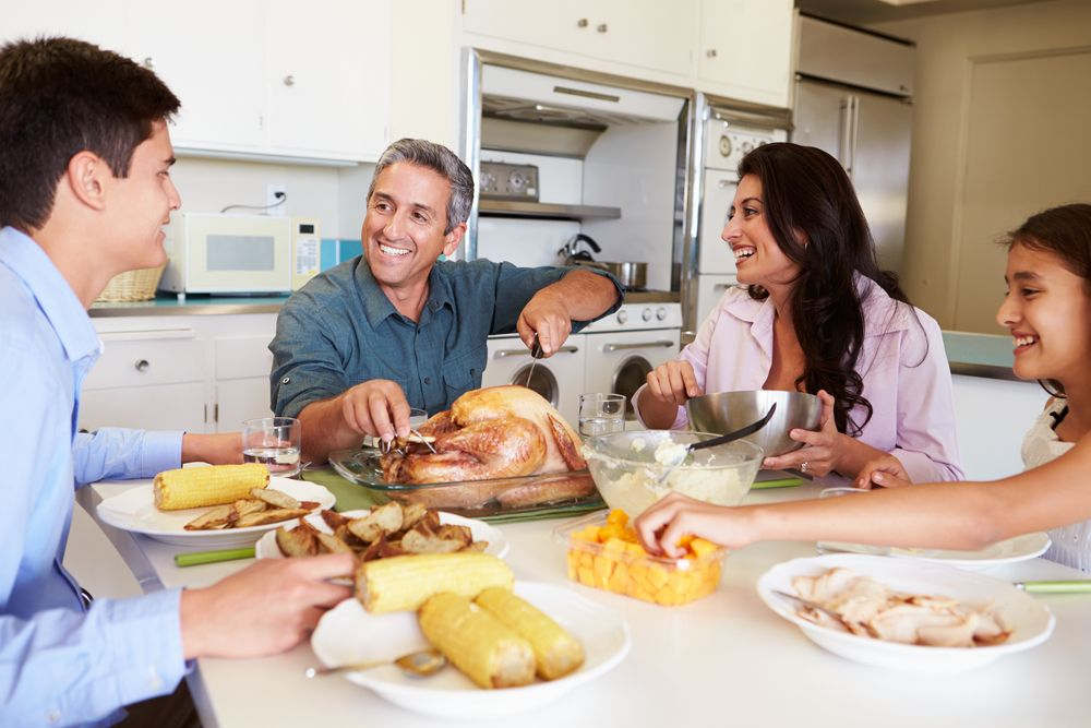 A family having dinner at home.   Source: Shutterstock