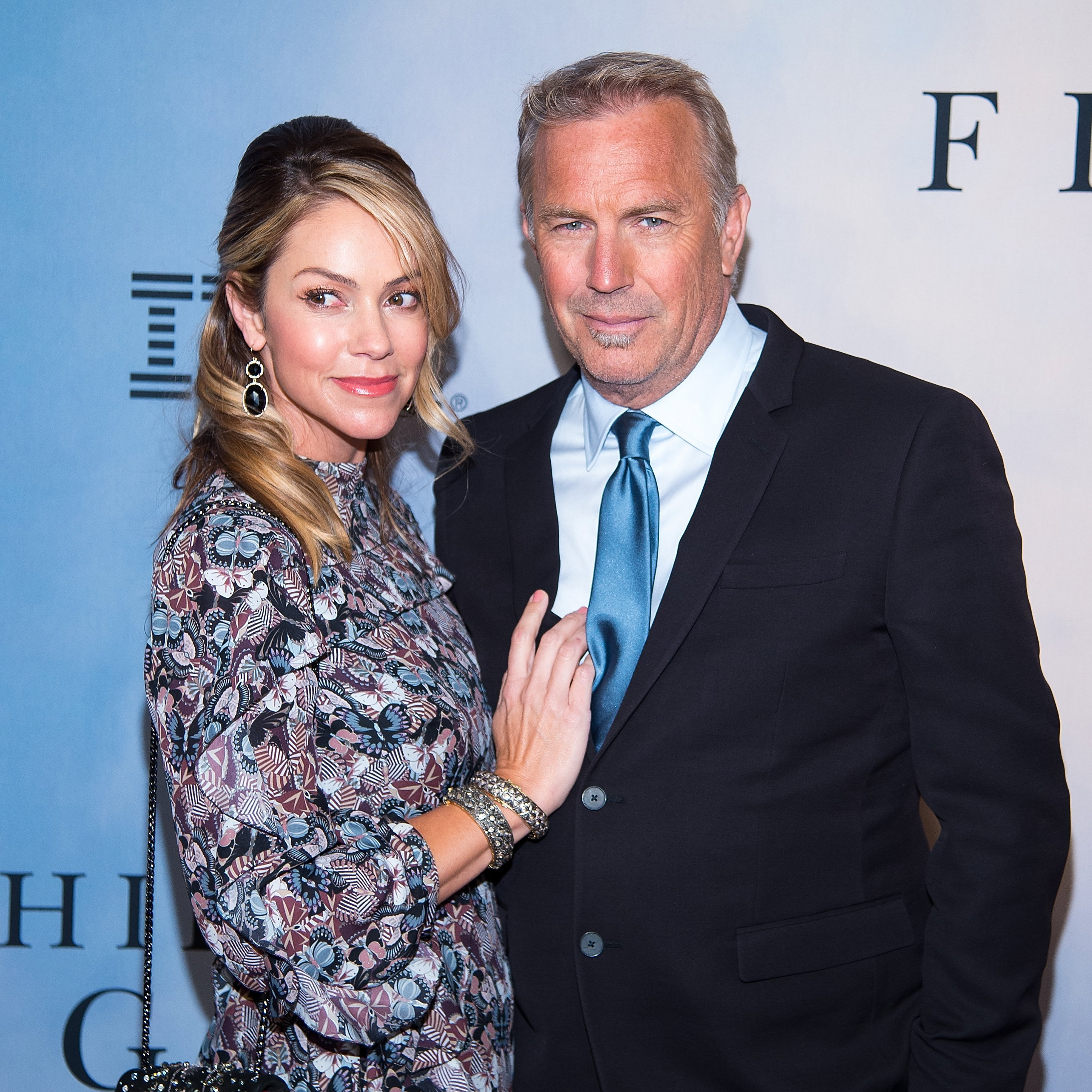 "Christine Baumgartner and Kevin Costner attend the ""Hidden Figures"" New York special screening on December 10, 2016 