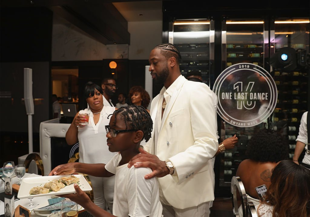 Zion Wade and Dwyane Wade attend Dwyane Wade's 16 Year NBA Career Celebration Dinner | Photo: Getty Images