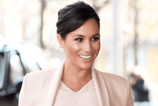 A smiling Meghan Markle. l Image: Twitter/ Marie Claire.