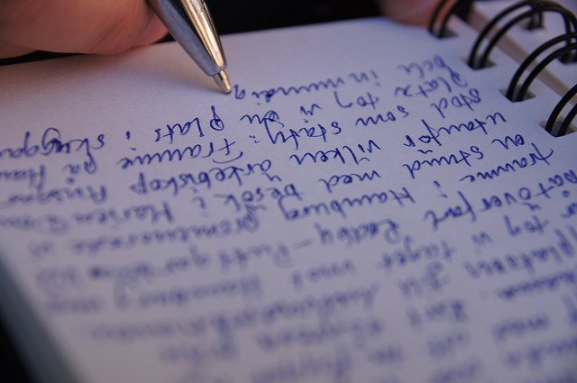 A person writing with a pen | Source: Flickr