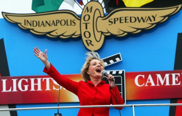 "Florence Henderson sings ""God Bless America"" during the IRL IndyCar Series 88th running of the Indianapolis 500 on May 30, 2004, at Indianapolis Motor Speedway in Indianapolis, Indiana. 