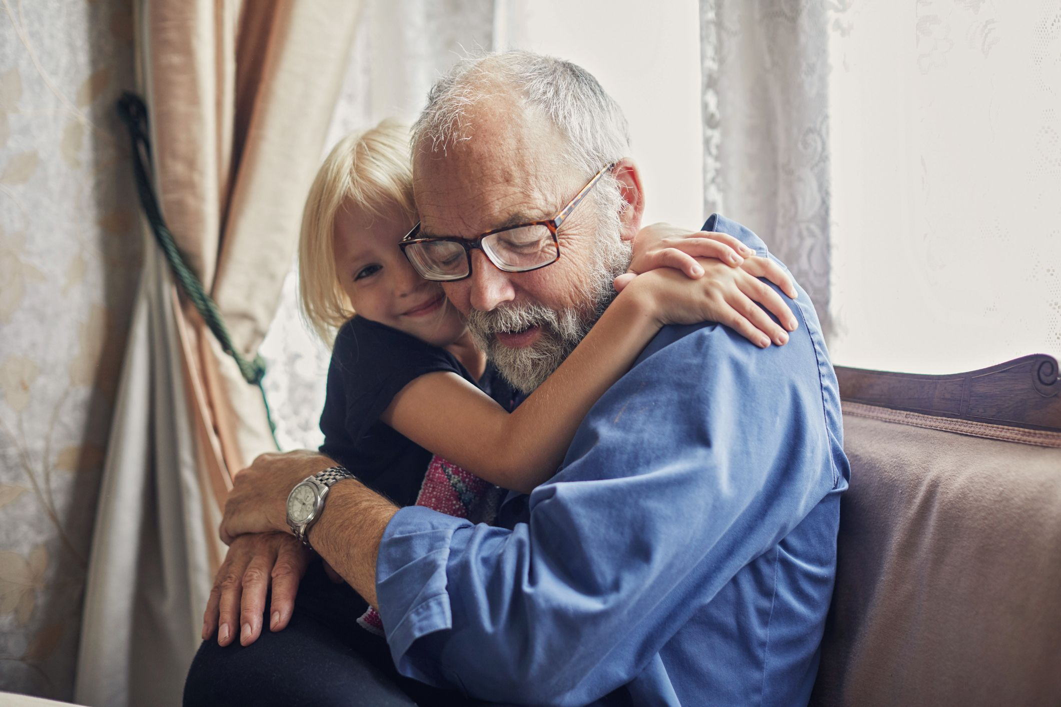 A grandfather hugging his grandson. | Source: Shutterstock