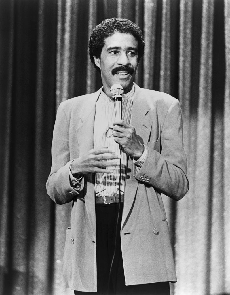 """Comedian Richard Pryor performing his stand-up comedy in a scene from the movie """"Richard Pryor: Live on the Sunset Strip."""" [Location and date unspecified] │ Source: Getty Images"""