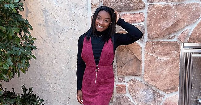 Simone Biles Looks Glamorous in Thanksgiving Pic Wearing Black & Pink Dress with Matching Boots