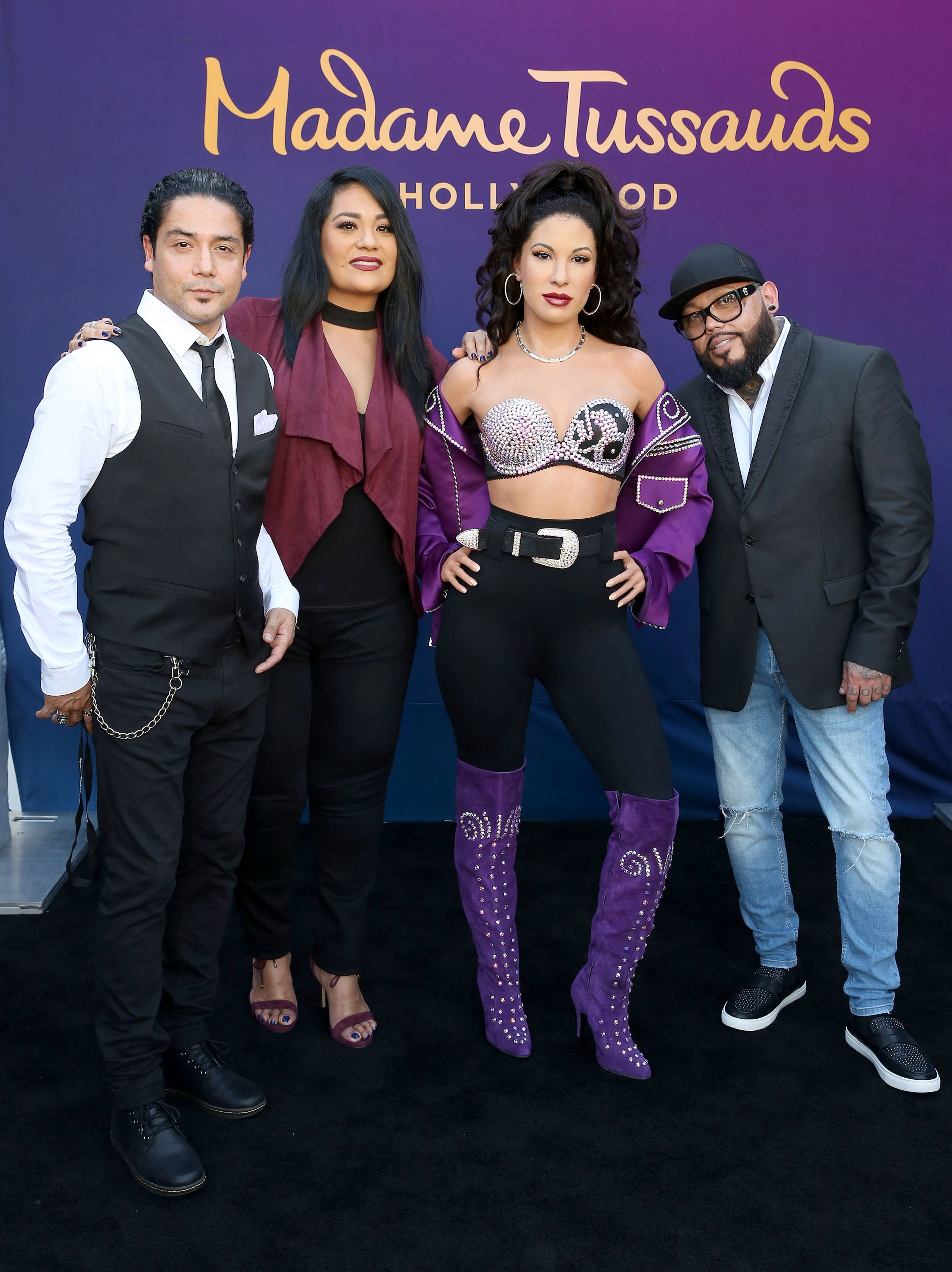 Selena's husband Chris Perez, sister Suzette Quintanilla and brother AB Quintanilla onstage during Madame Tussauds Hollywood's unveiling of Grammy award winner and cultural icon Selena Quintanilla immortalized in wax at Madame Tussauds on August 30, 2016 in Hollywood, California. | Photo: Getty Images