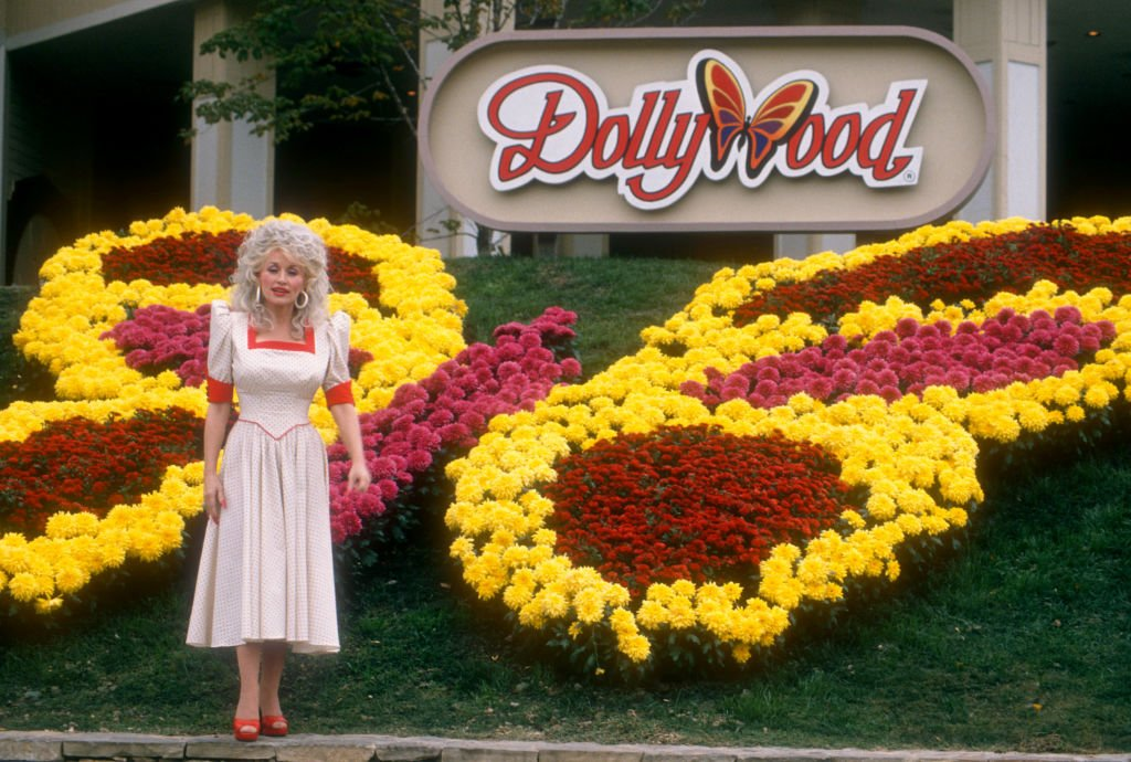 Dolly Parton posing for photos in front of her amusement park, Dollywood, in Knoxville-Smoky Mountains metroplex, Pigeon Forge, Tennessee, onOctober 24, 1988.   Photo: Getty Images