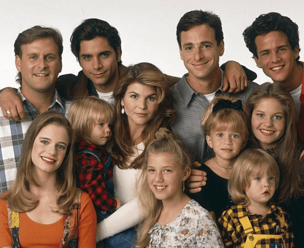 """""""Full House"""" Season Seven cast pose for a promotional picture, which includes; Dave Coulier, Andrea Barber, John Stamos, Blake Tuomy-Wilhoit , Lori Loughlin, Jodie Sweetin, Bob Saget, Ashley Olsen, Dylan Tuomy-Wilhoit, Candace Cameron and Scott Weinger, on September 14 1993 