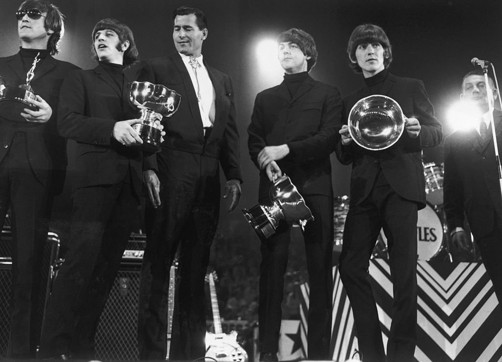 The Beatles collect their awards at the NME Poll Winners Concert in Wembley, 1st May 1966 | Getty Images / Global Images Ukraine