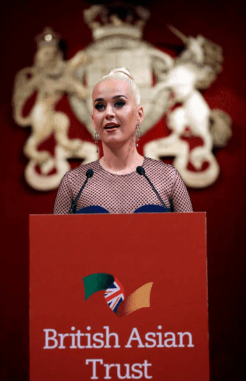 Katy Perry stand at a podium as she says a speech during the reception for the British Asian Trust, on February 4, 2020, in London, England | Source: Kirsty Wigglesworth - WPA Pool/ Getty Images