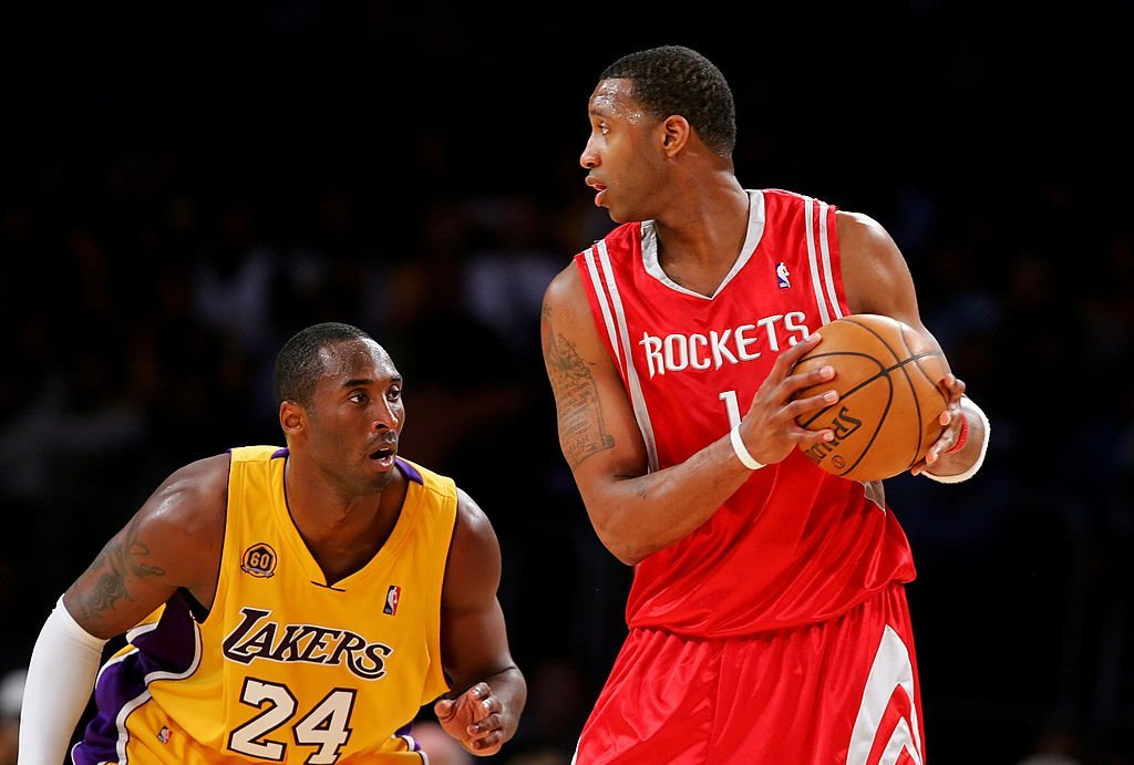Kobe Bryant #24 of the Los Angeles Lakers puts the pressure on Tracy McGrady #1 of the Houston Rockets at Staples Center | Photo: Getty Images