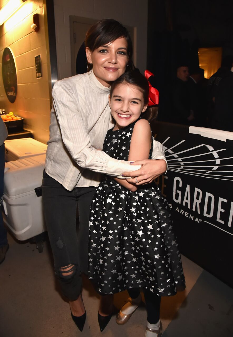 Katie Holmes and Suri Cruise attend the Z100's Jingle Ball. | Source: Getty Images