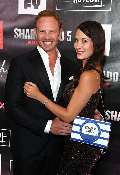 "Ian Ziering (L) and his wife Erin Kristine Ludwig attend the premiere of ""Sharknado 5: Global Swarming"" at The LINQ Hotel & Casino on August 6, 2017, in Las Vegas, Nevada. 