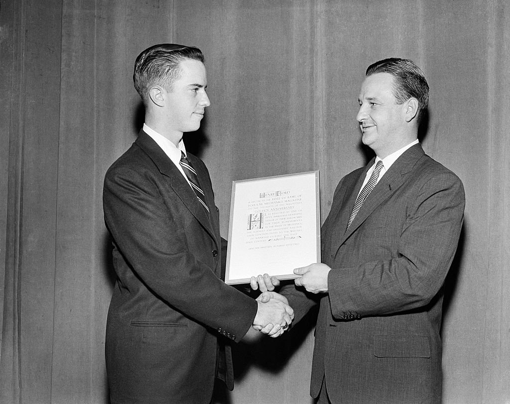 """Benson Ford Sr. gives a Henry Ford award to a young winner on the """"Toast of the Town"""" show in New York, circa 1952 