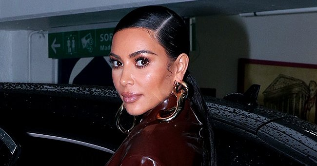 Kim Kardashian from KUWTK Shows off Her Curves in Tight Orange & Chocolate Brown Balmain Latex Suits