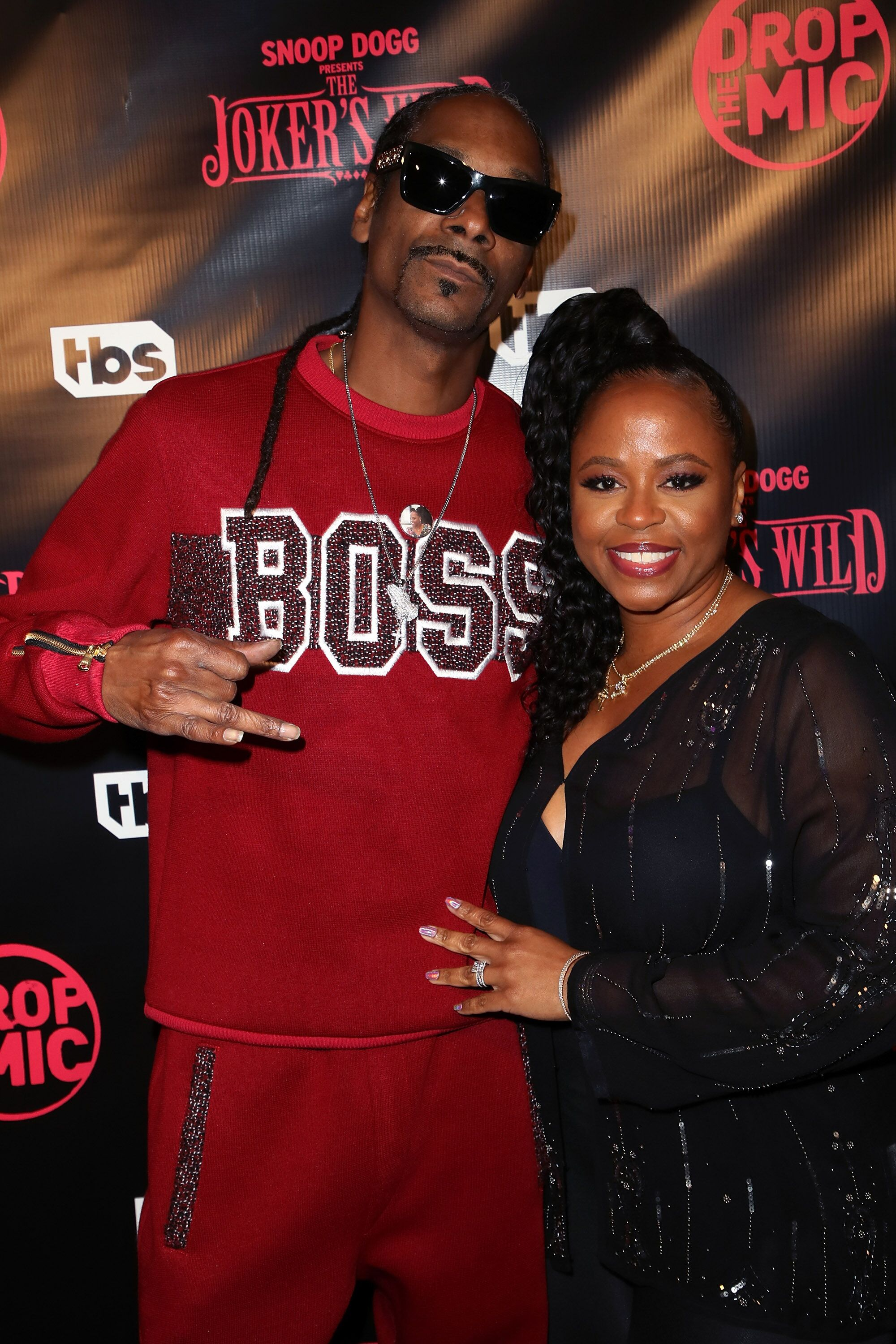 "Rapper Snoop Dogg (L) and wife Shante Broadus attend the premiere for TBS's ""Drop The Mic"" and ""The Joker's Wild"" at The Highlight Room 