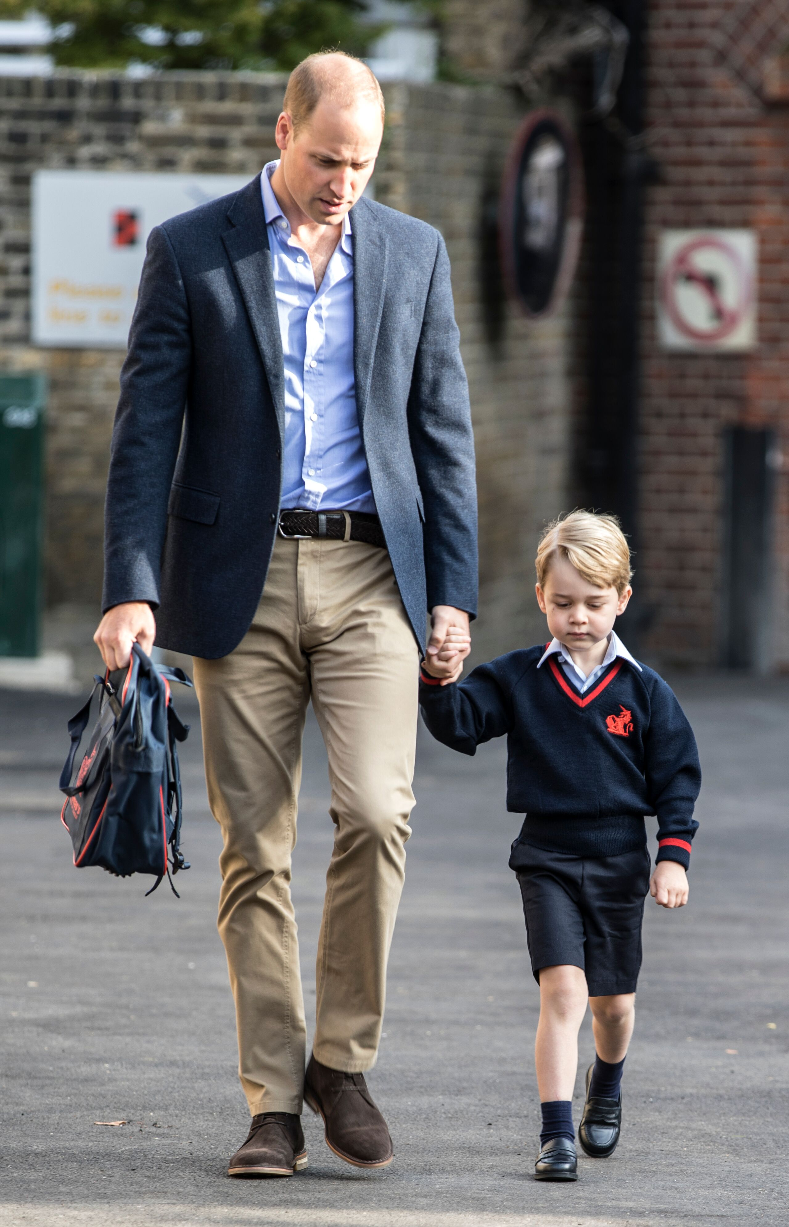 Prince George arrives for his first day of school at Thomas's Battersea with his father Prince William.   Source: Getty Images
